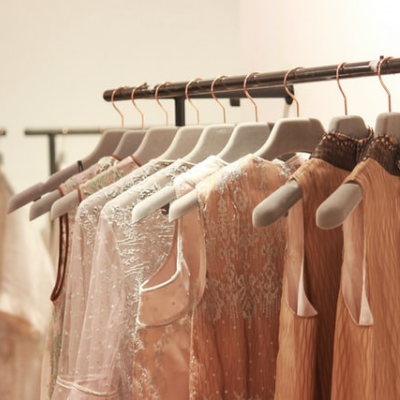 Assorted tops on hangers. Ethical fashion is all about choosing the right clothes.